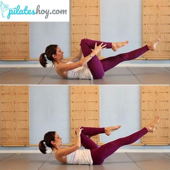 single leg stretch pilates ejercicio